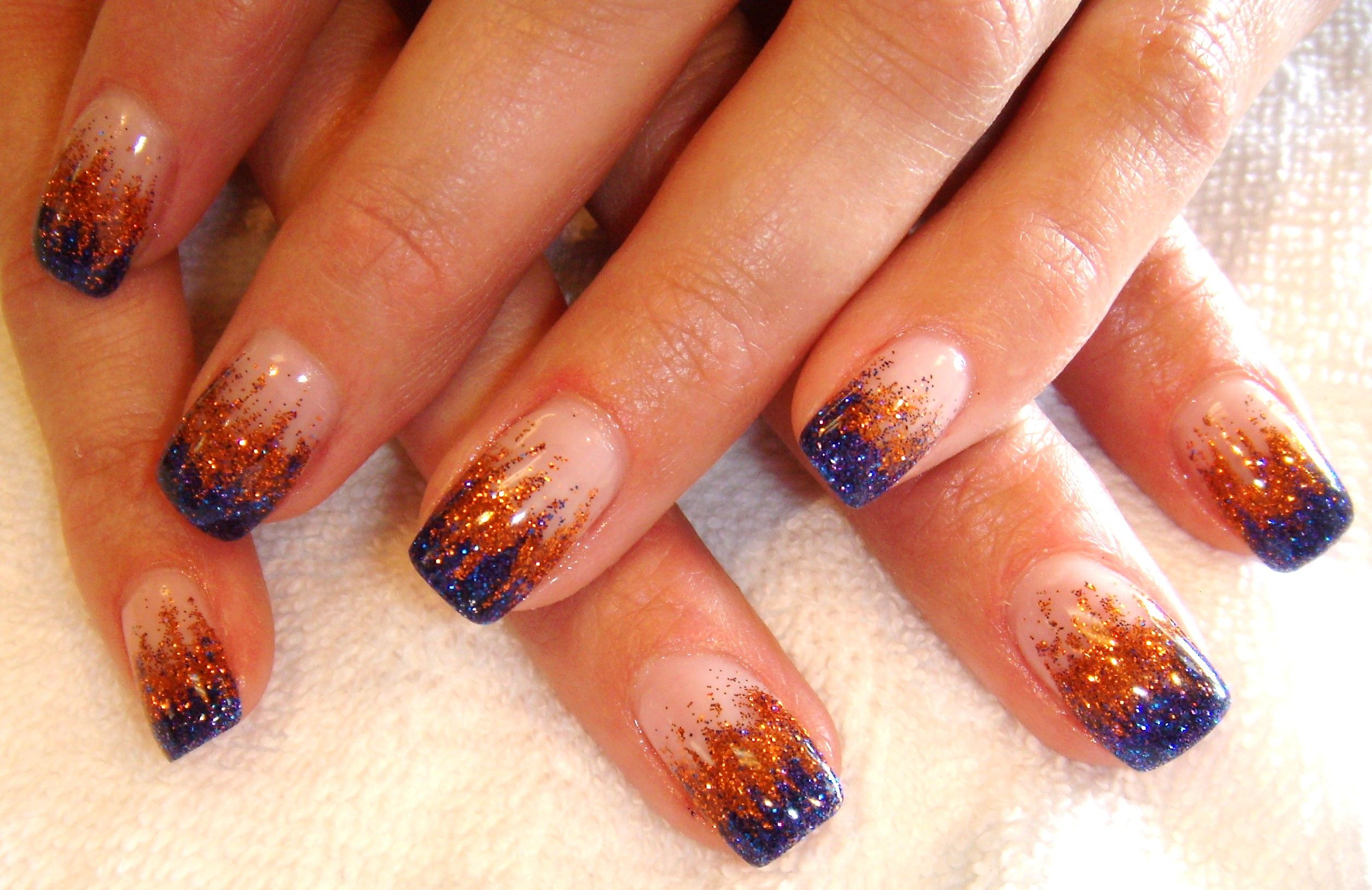Blue/orange glitter nail design. How very Hunger Games appropriate ...