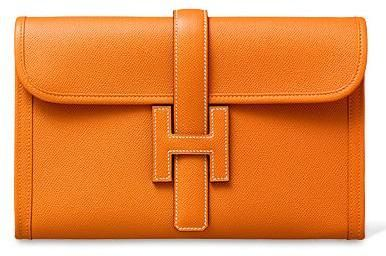 Hermès Jige clutch in classic orange.