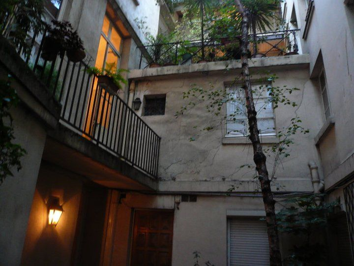 This is the courtyard of the apartment where we stayed on our Parisian honeymoon. Top floor with all the plants is our little terrace.