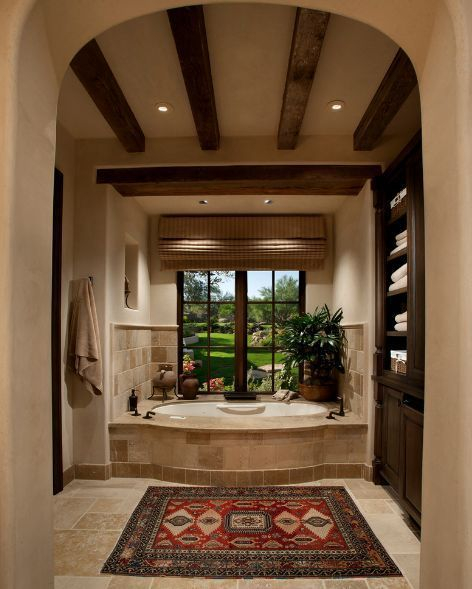 Mid-sized Tuscan master bathroom photo with dark wood cabinets beige on