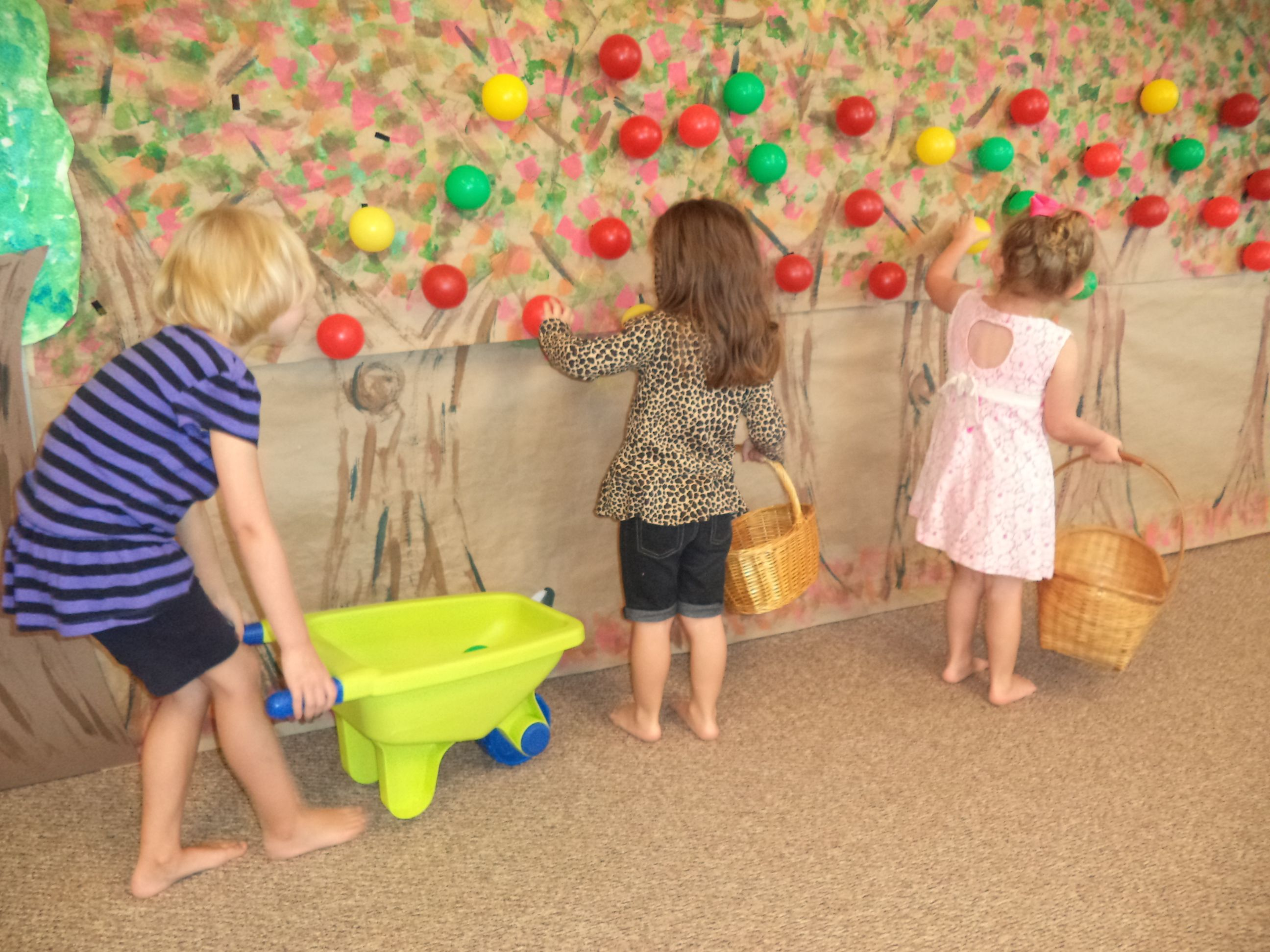 Interactive apple picking wall for dramatic play. Make a tree mural, add velcro to wall and to ballpit balls.  Use baskets, wheelbarrows.
