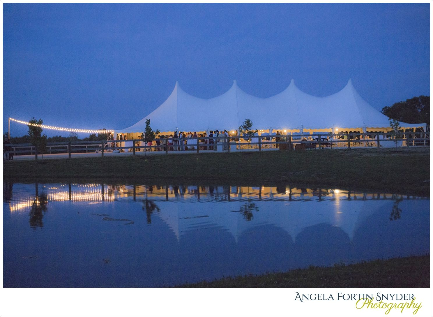 Nighttime shot of farm tent wedding with reflection in the pond..so pretty!