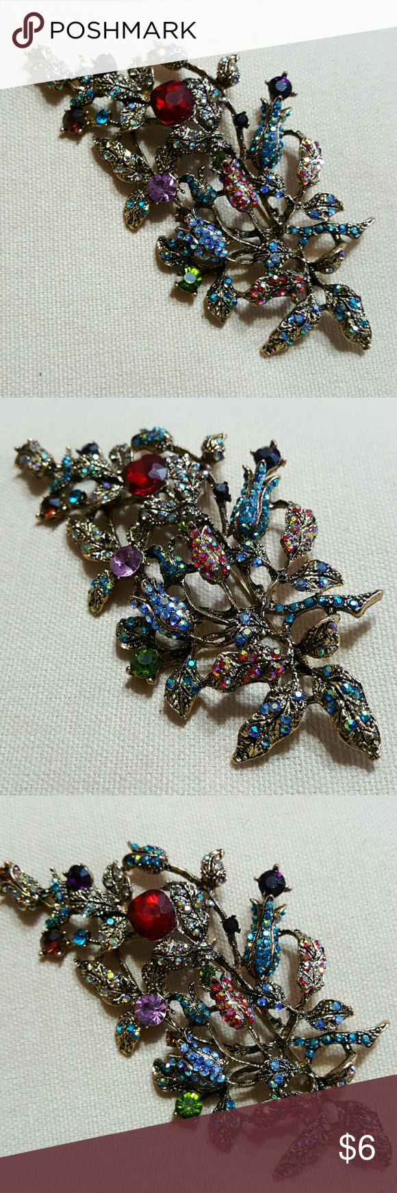 Rhinestone Pendant Brooch Beautiful flower filled brooch that can be worn 2 different ways.  Feel free to ask any questions before purchasing.  Thanks for shopping my closet! Metal Gallery  Jewelry Brooches