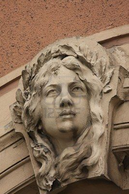 Detail of woman's head on Art Nouveau house in Riga