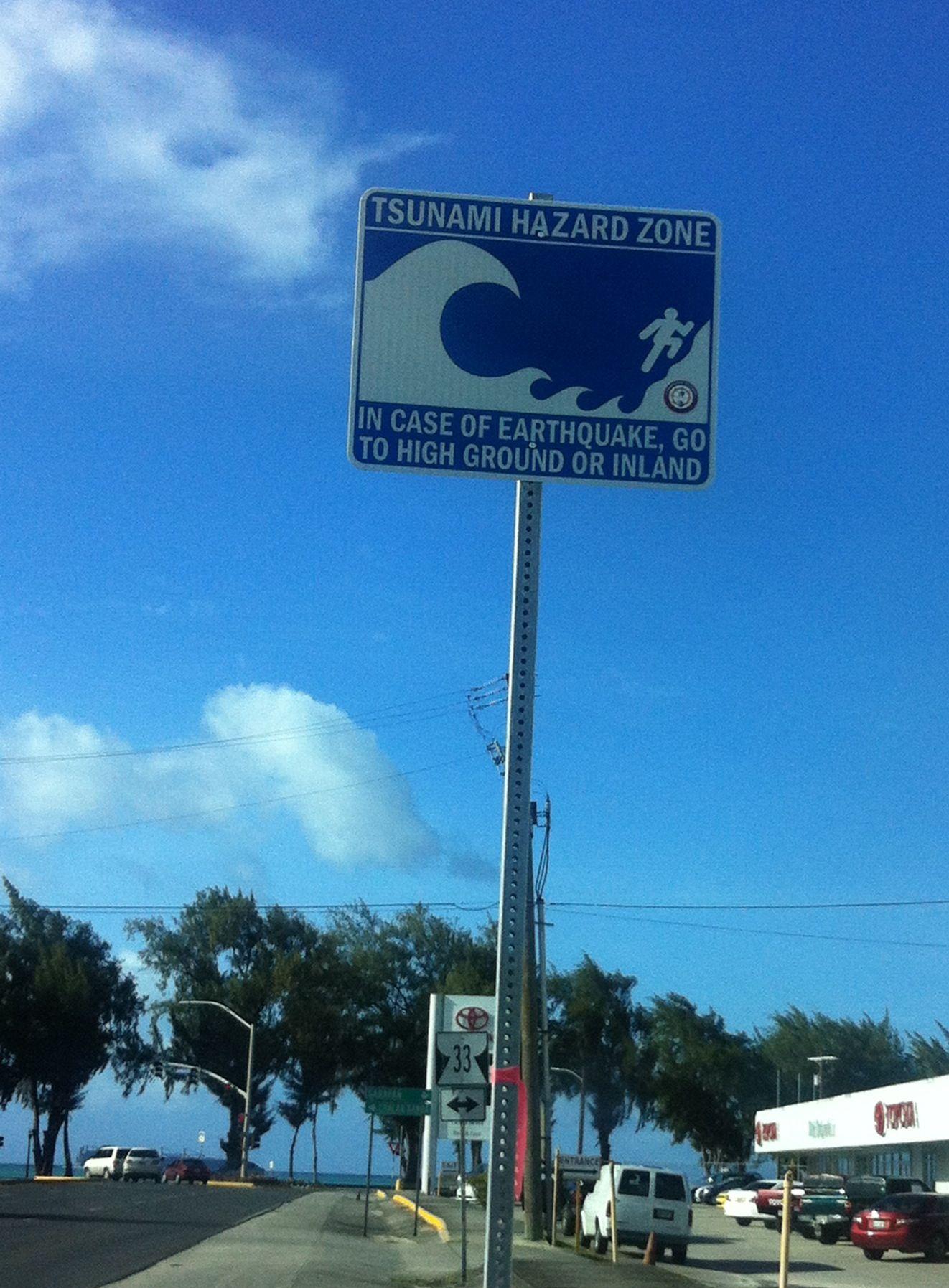 tsunami hazard sign along beachroad intersection island