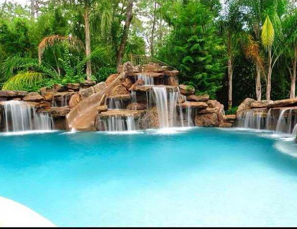 Love This Pool With A Slide Waterfall Combo Looks Like A Resort Swimming Pool Prices Custom Swimming Pool Luxury Swimming Pools
