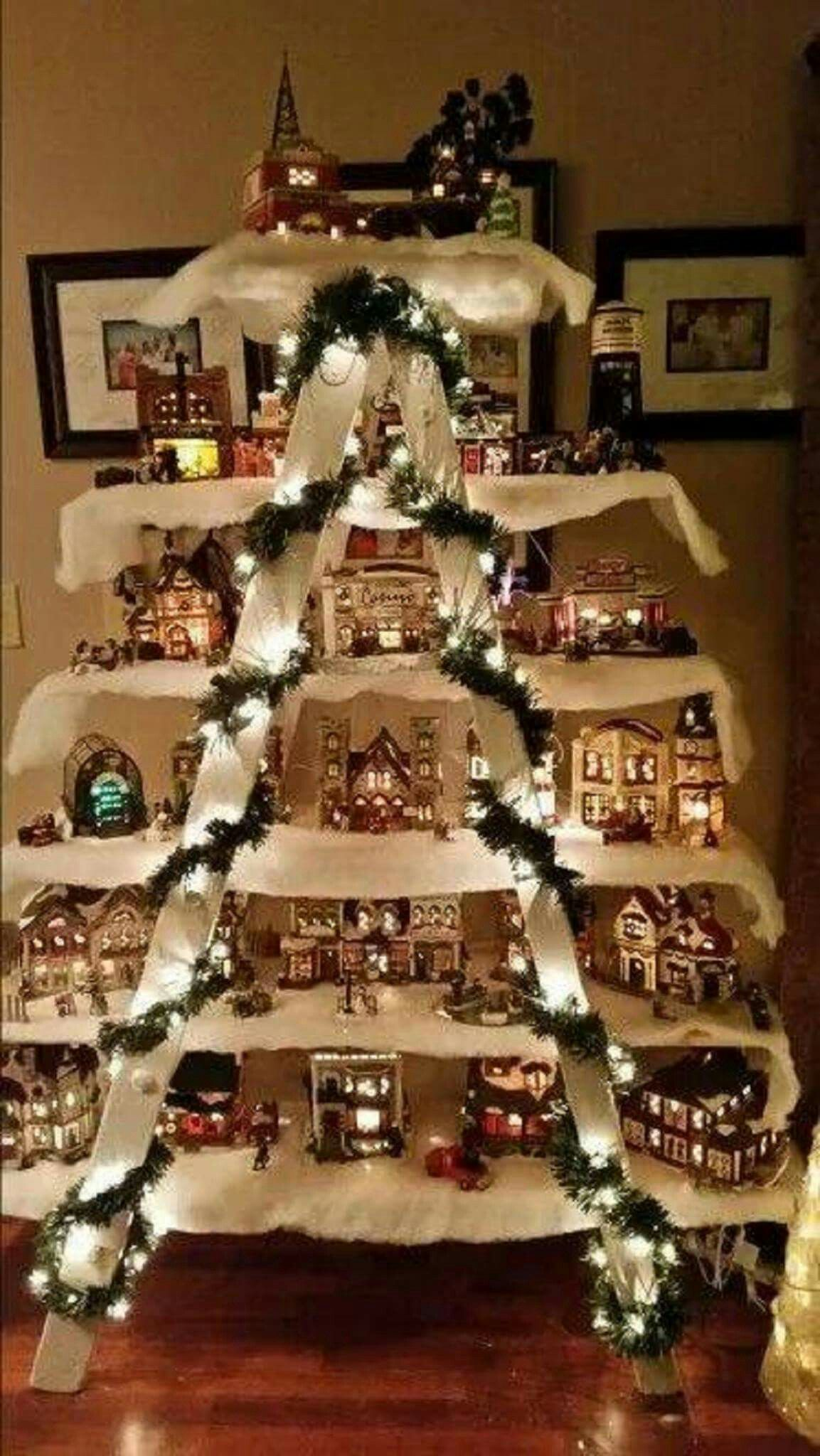 Christmas Village Displayed on shelves on a ladder
