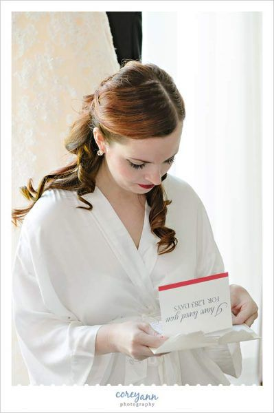 bride reading letter from groom before wedding at Waters Edge