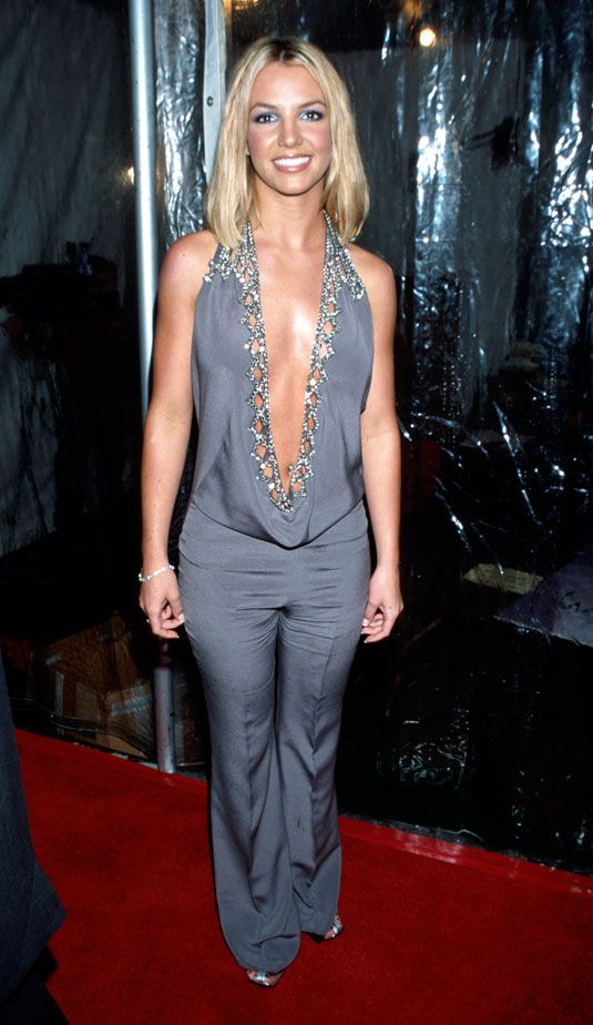 8bcdbe179c1 Britney Spears s Sparkly Gray Jumpsuit With the Panty-Skimming Cowl Neck At  The 2000 AMA s Aka The 2000 s American Music Awards.