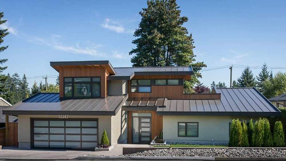 Image of a modern house with standing seam metal roof for Tin roof house designs