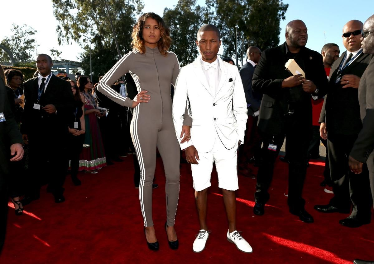 1c917bde8cecb Helen Lasichanh (L) and recording artist Pharrell Williams attend The 57th  Annual GRAMMY Awards at the STAPLES Center on February 8
