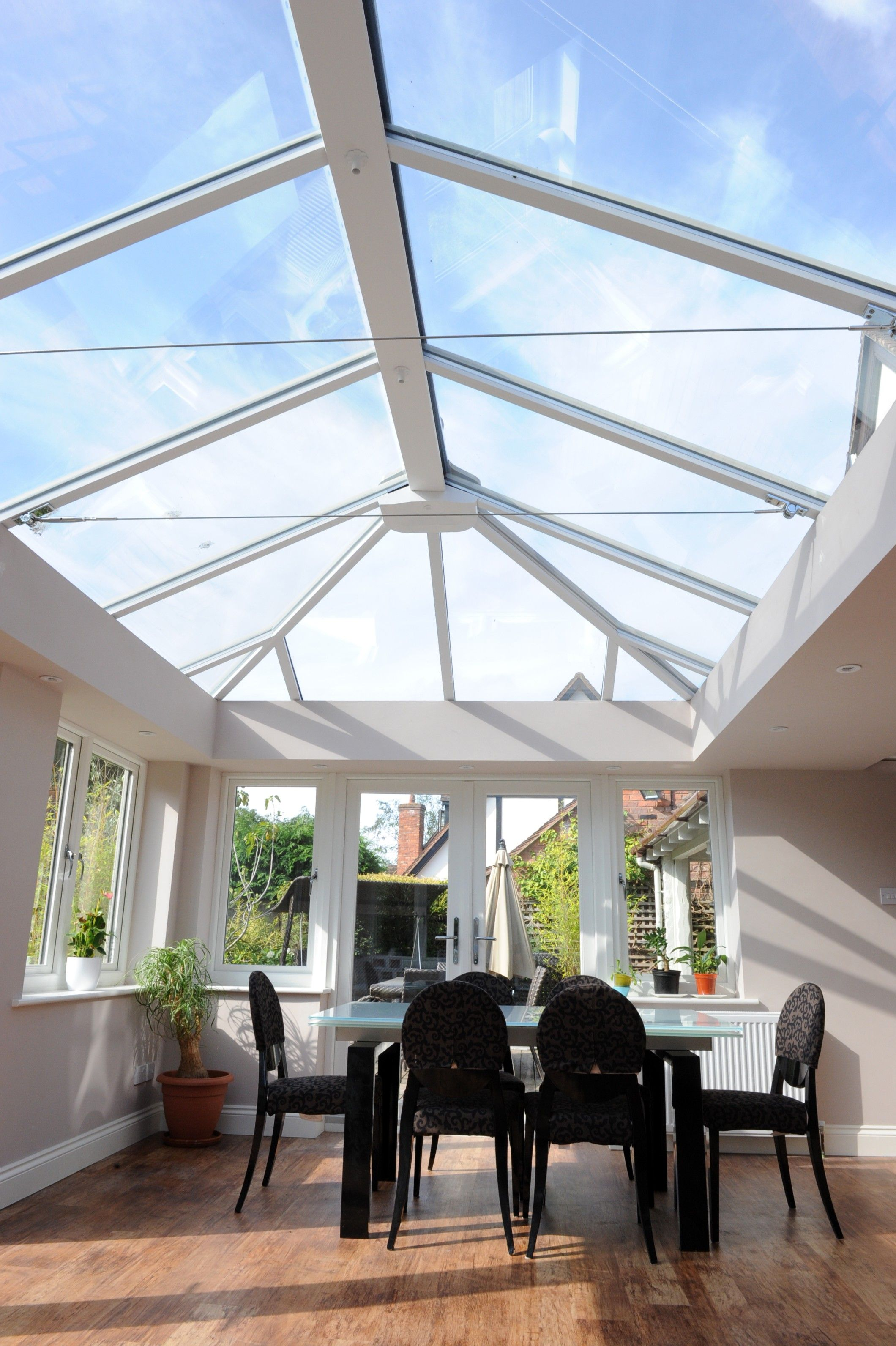An Ultraframe Conservatory with a Glass Roof | Glass roof ...