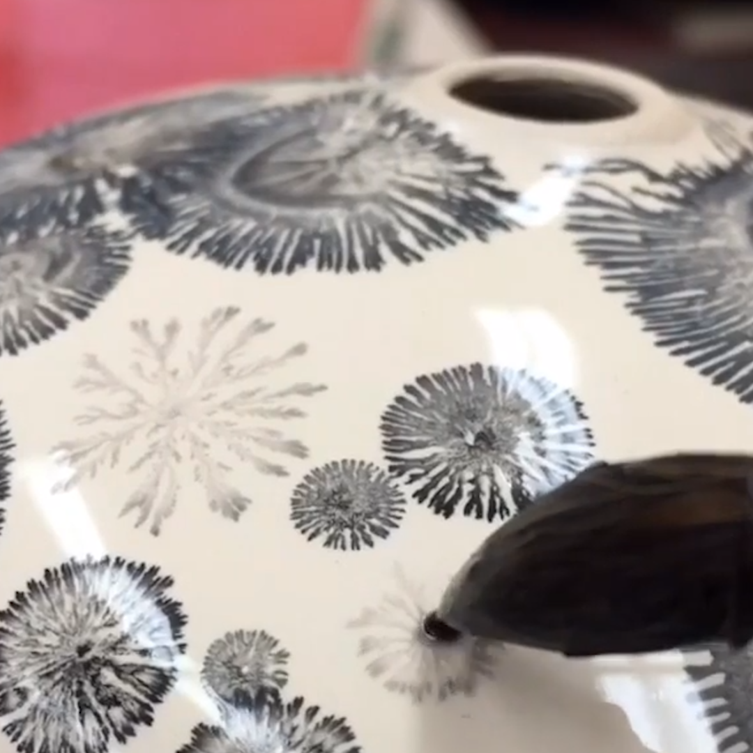 These pottery designs are created by a chemical reaction