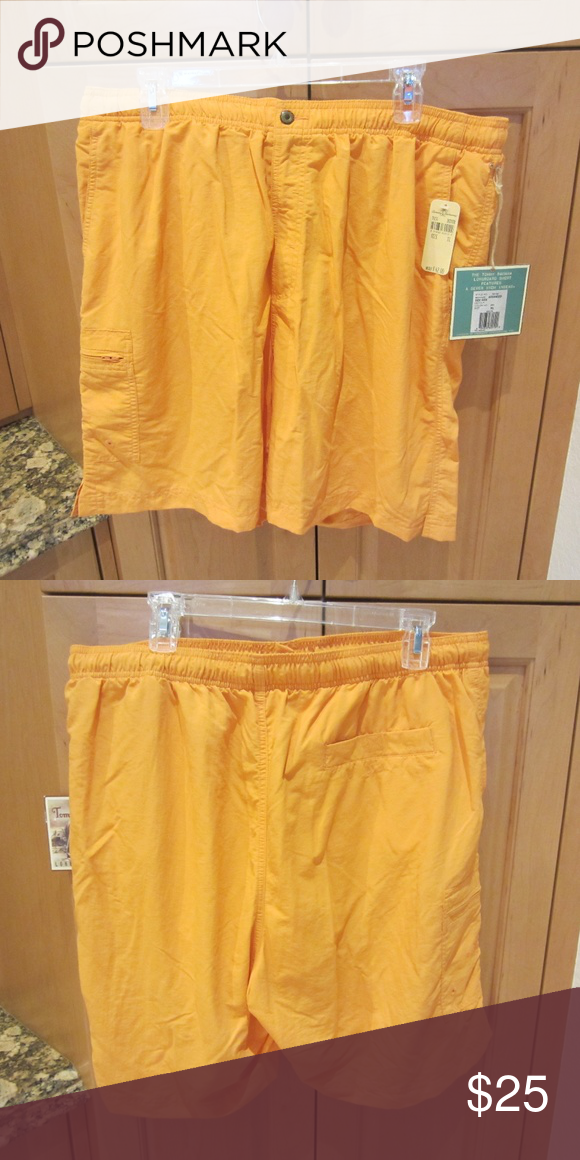 Tommy Bahama Men's Bathing Suit Tommy Bahama advanced side kick men's bathing suit; 100% nylon with mesh lining; button and zipper front; zipper front pocket; rear pocket; Color is detour (orange); Tommy Bahama longboard short features a 7 inseam; brand new Tommy Bahama Swim Swim Trunks #mensbathingsuits