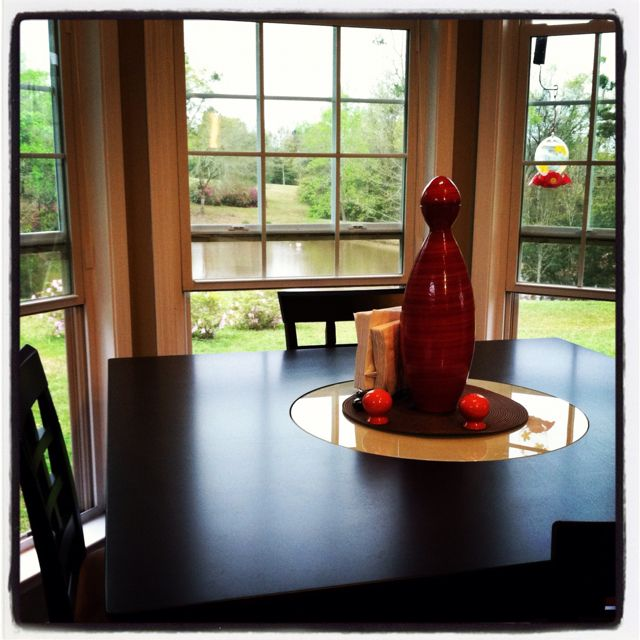Great lake view from kitchen. Loving the table with a lazy susan.
