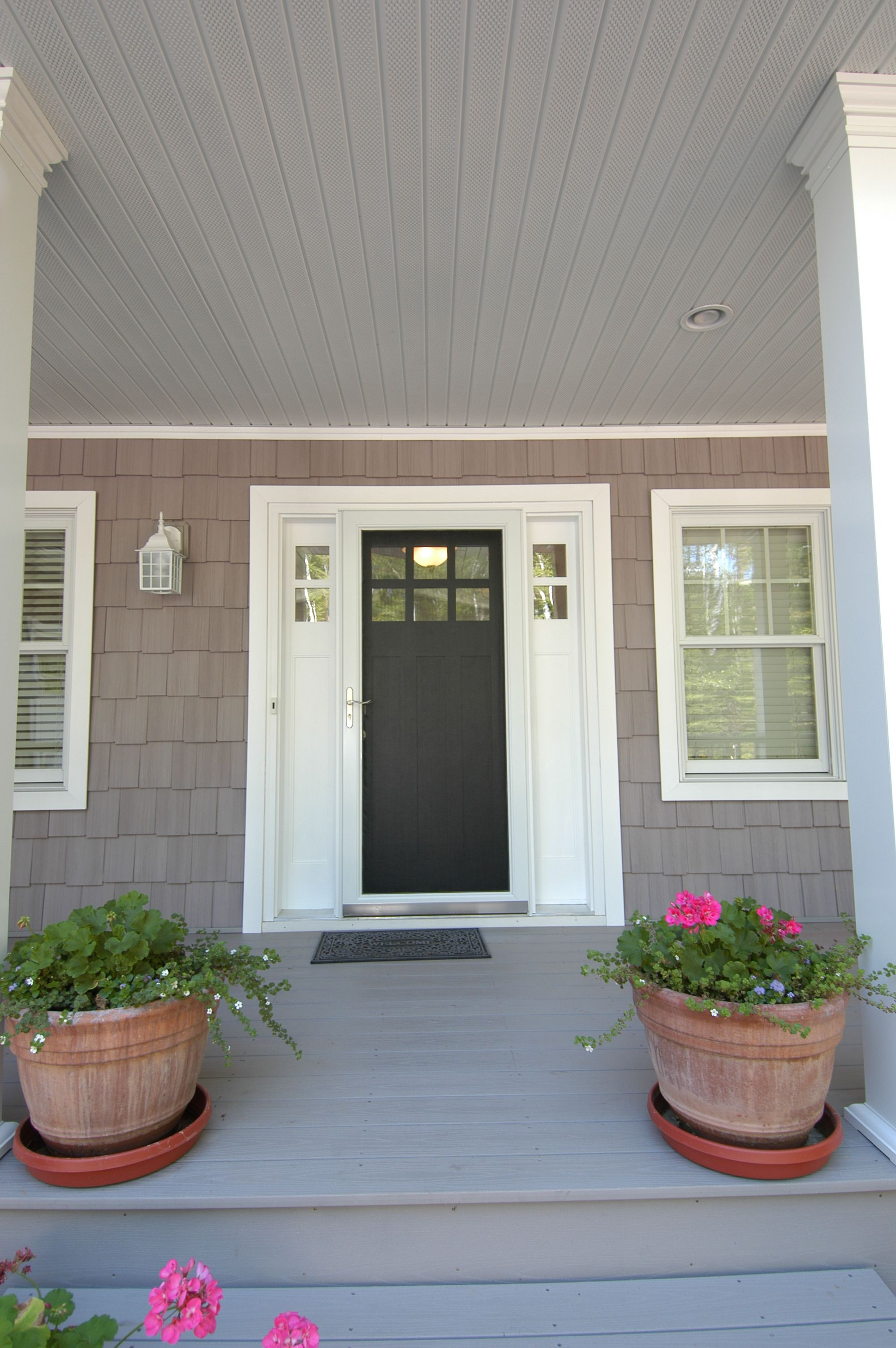 Painted wood craftsman front door with a sidelight on each for Front door with window on top