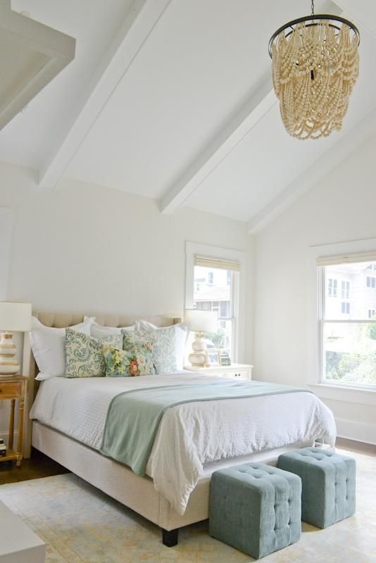 Vaulted Ceilings And Walls Painted Behr S Silky White Create A Sense Of Openness Elegant Restfulness In The Master Bedroom Where Accents Blues