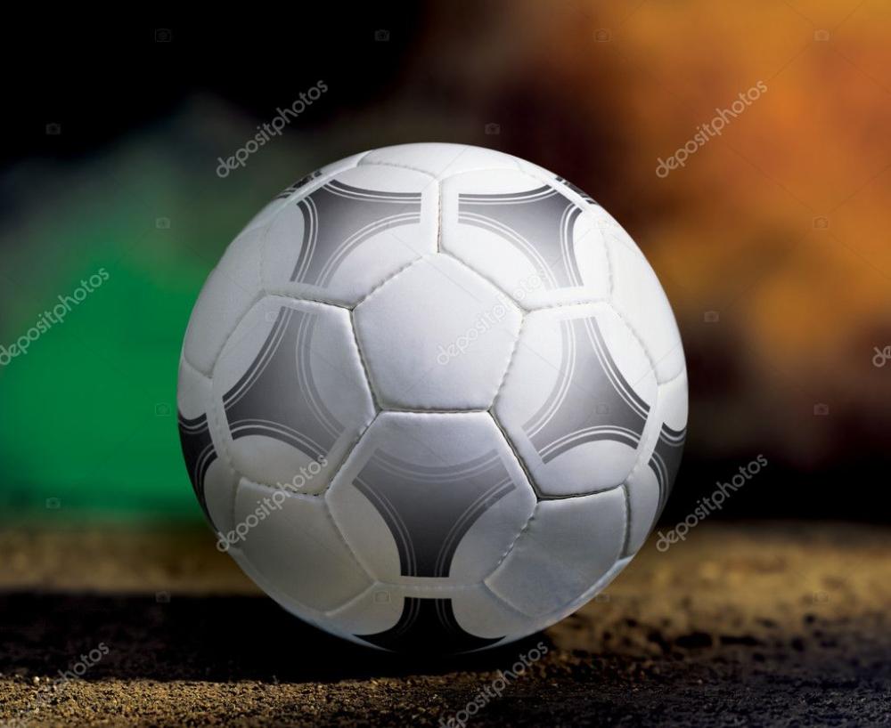 closeup soccer ball on ground at sun day win FIFA