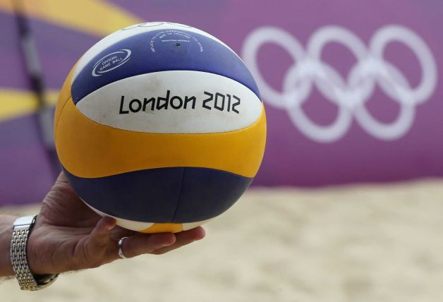 An Unidentified Coach Holds A Ball During A Practice Session At The Beach Volleyball Venue At The 201 Volleyball Pictures Beach Volleyball 2012 Summer Olympics