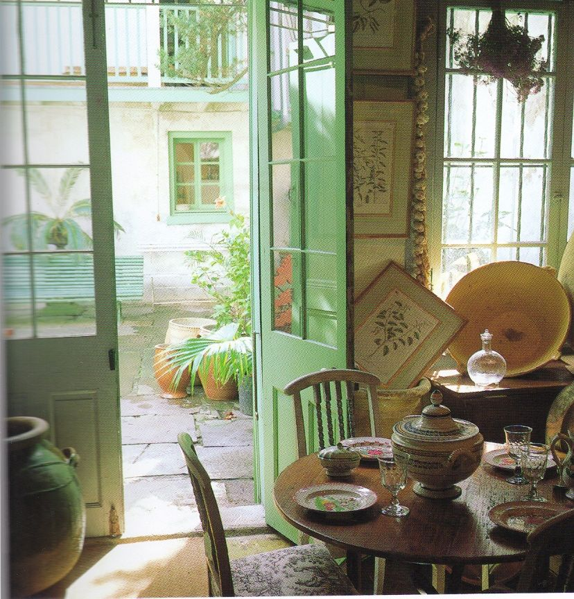 Lucullus shop in the Quarter. French doors open onto courtyard. From New Orleans Elegance and Decadence http://www.richardsextonstudio.com/elegance.html