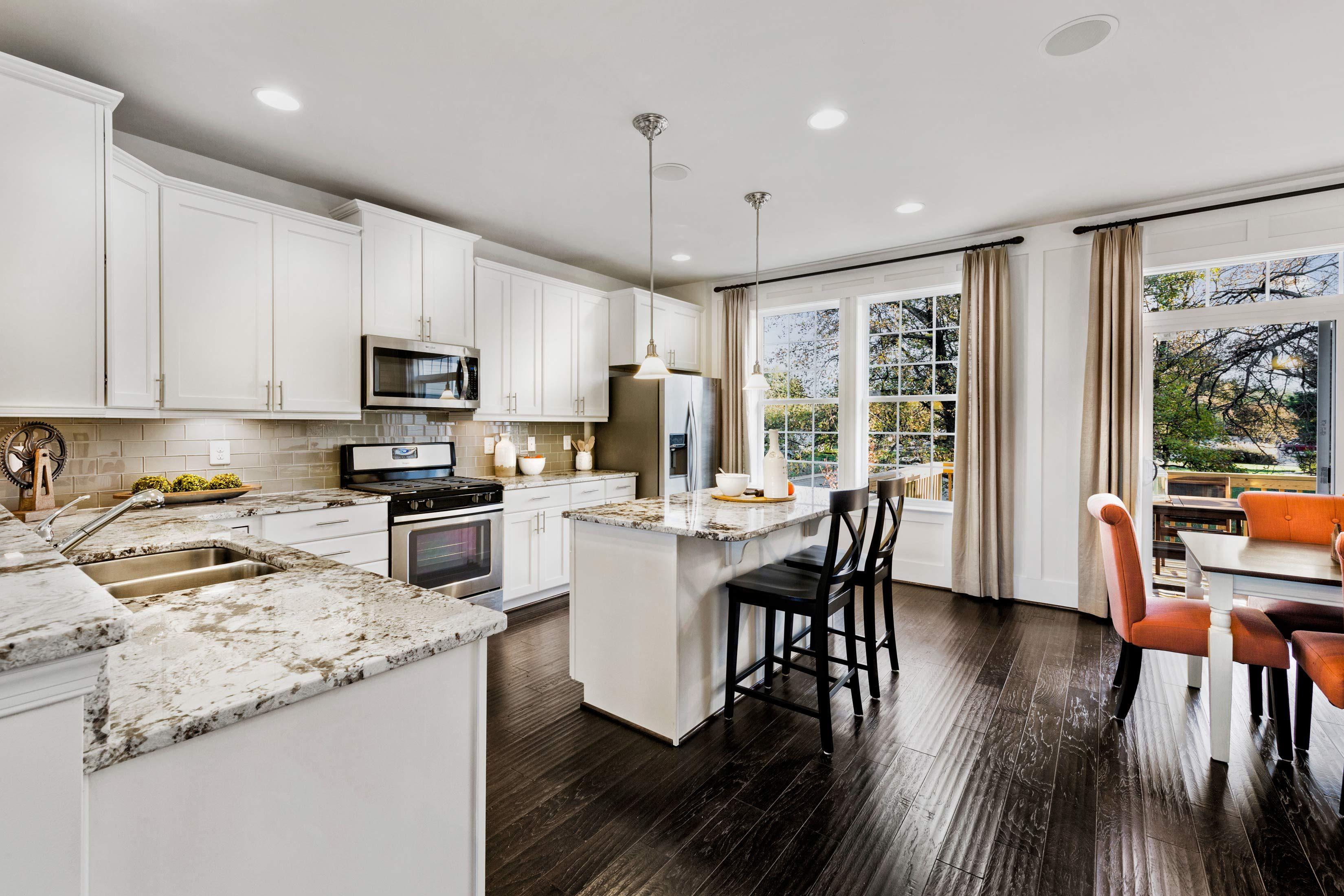 Beautiful Open Floorplan Kitchen Area And Dining Room In The Davenport Townhome Interior Design Photography Dan Ryan B Open Floor Plan Kitchen Home Townhouse