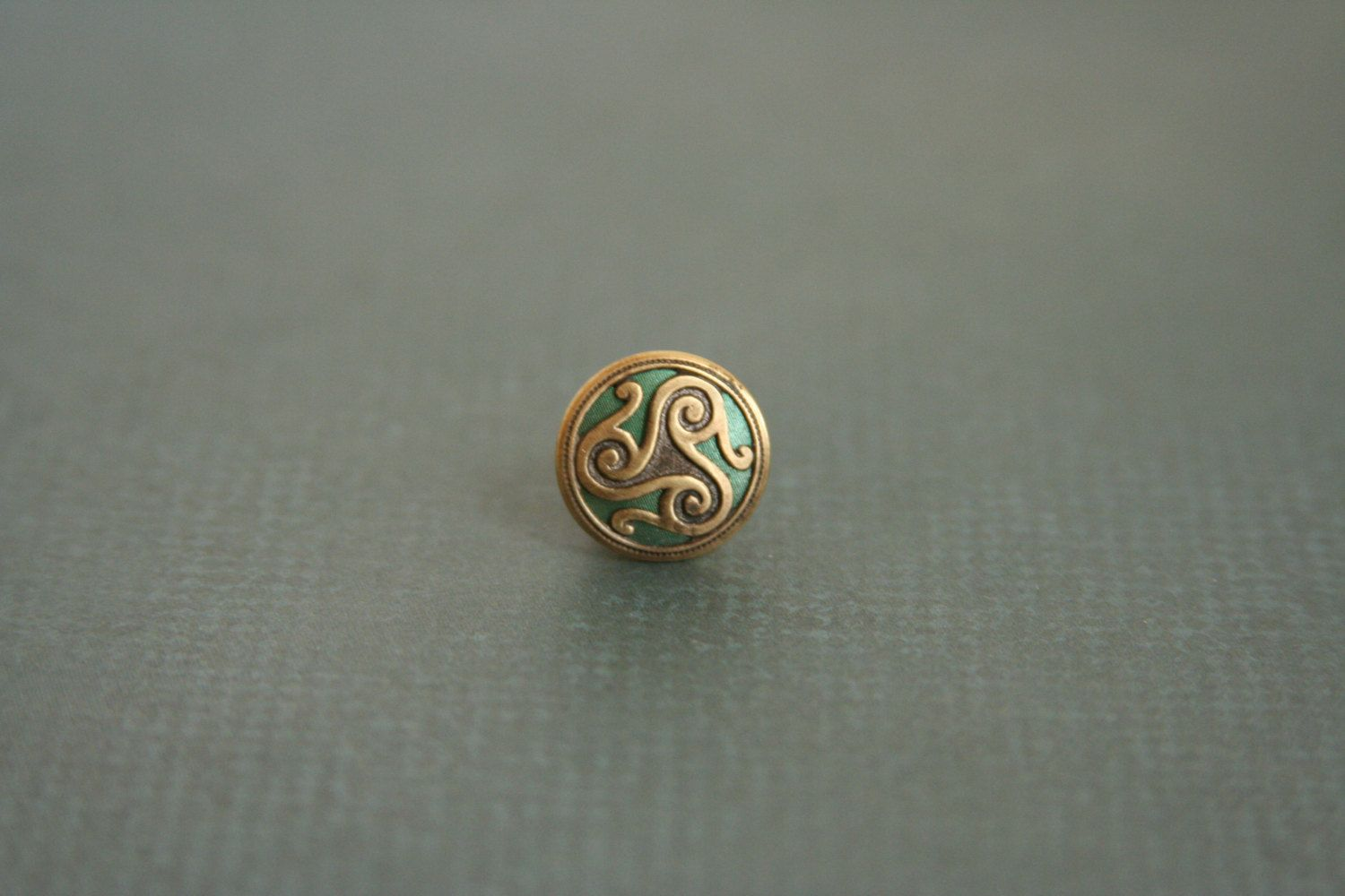 Triskele Tie Tack Triskelion Green Lapel Pin - made with a unique green and brass button by AngleAh on Etsy