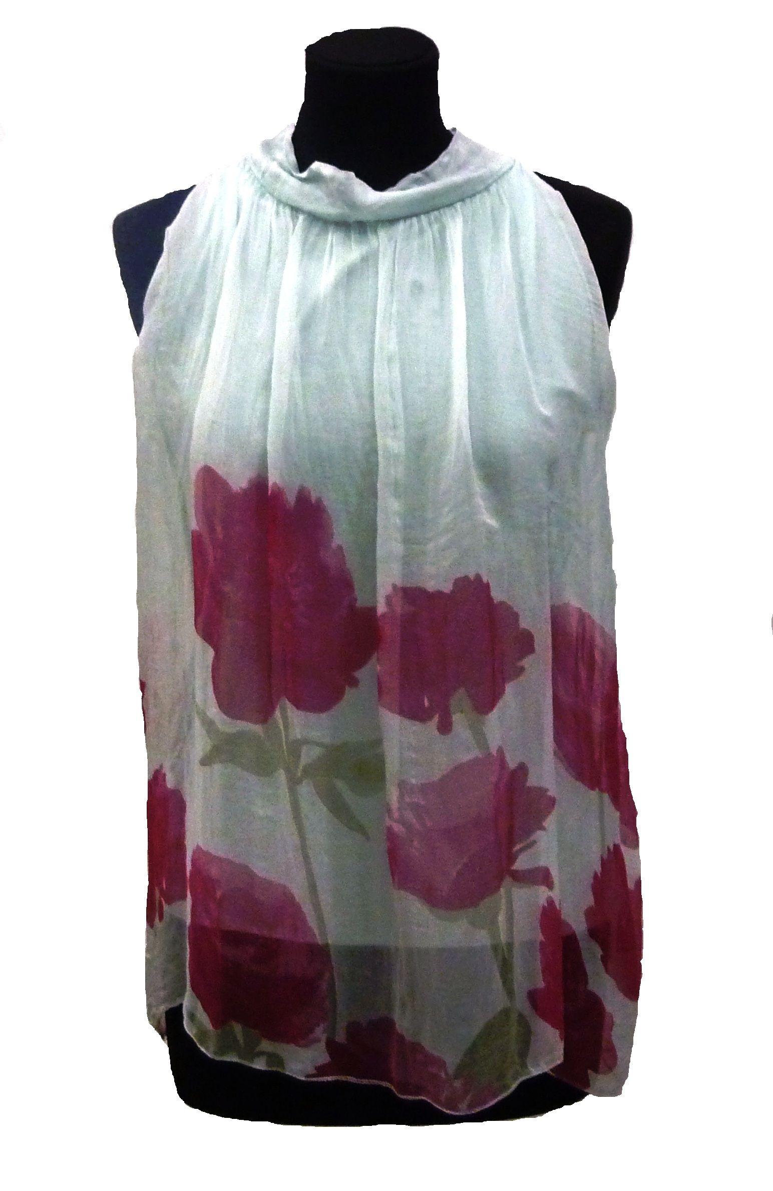 Alegre top al cuello, en menta y flores rosas. Disponible