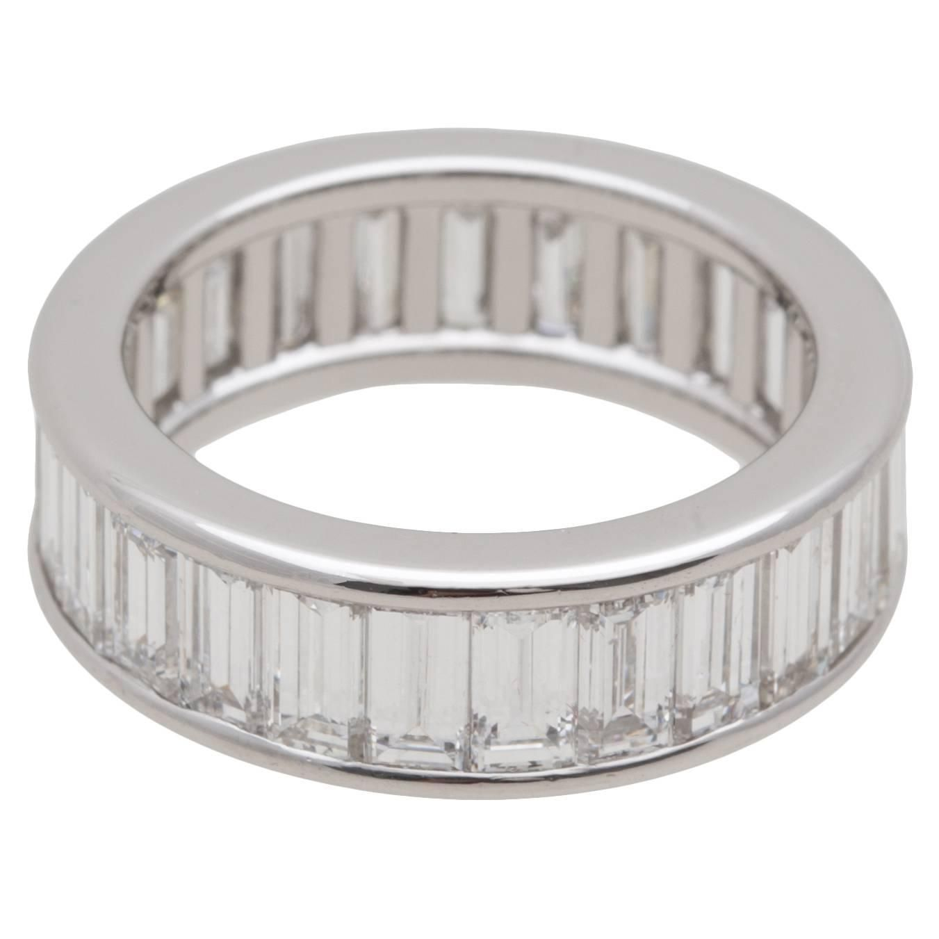 Cartier Diamond Baguette Platinum Eternity Wedding Ring | From a unique collection of vintage wedding rings at https://www.1stdibs.com/jewelry/rings/wedding-rings/