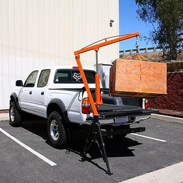 MaxxHaul 70238 Receiver Hitch Mounted Crane hoisting cargo into truck bed.