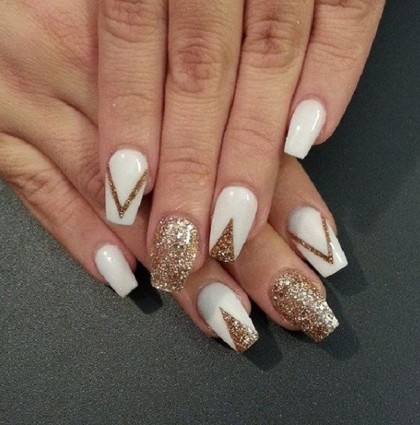 Amazing looking white and gold nail art design. The nails are painted in white  nail - 45 Gold Nails You Wish To Try Gold Nail Art, White Nail Polish