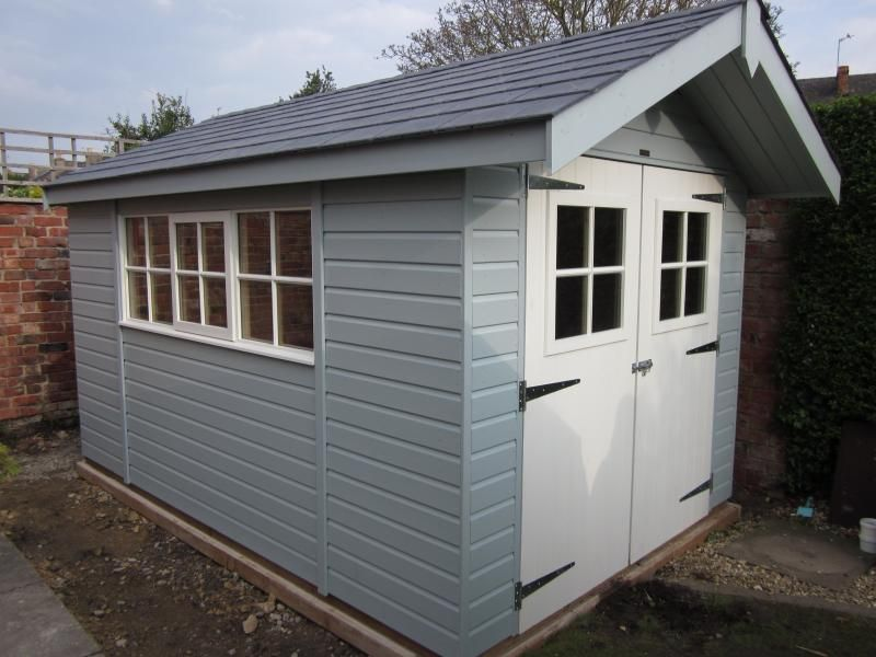 Garden Sheds Installed garden shed with overhang this fantastic new light blue shed