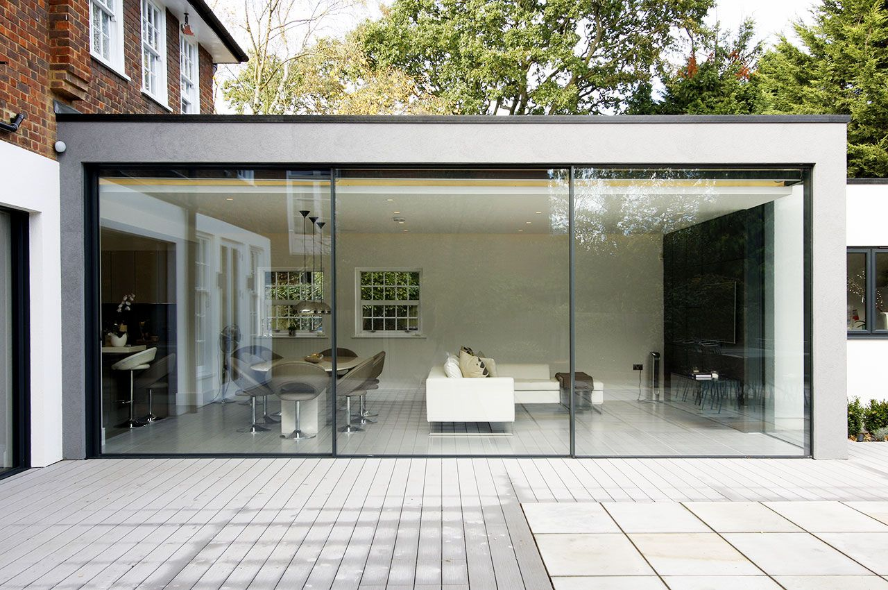 Modern Glass Extensions the glass balustrades are almost invisible agaisnt the minimal