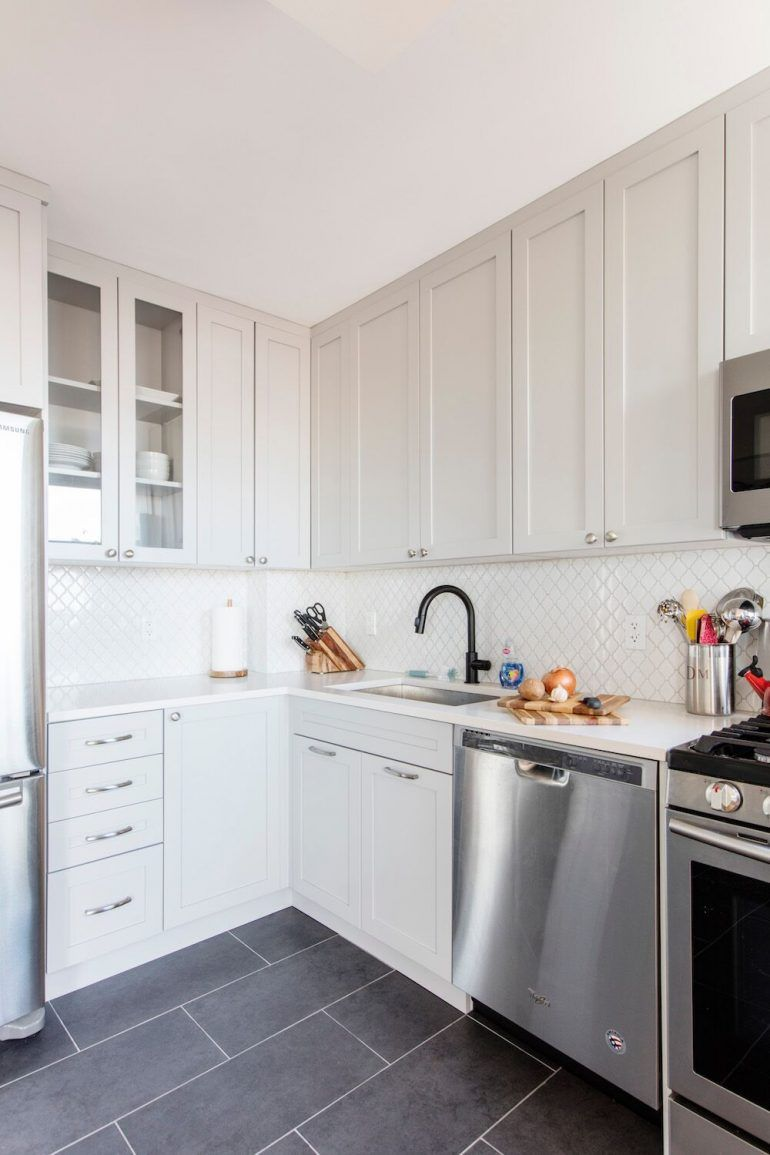 Shaker Style Cabinets Were Semi Custom In A Cool Soft Gray And Paired With Backsplash Made Of Small Scale White Tile Laid Diamond Pattern