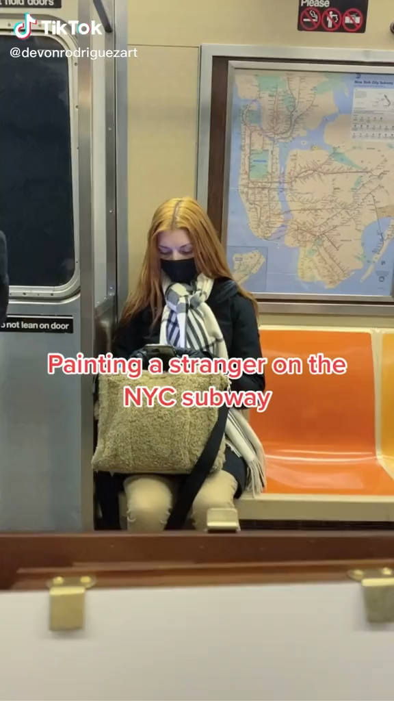 Painting a stranger on the subway results in surprise followed by tears of happiness