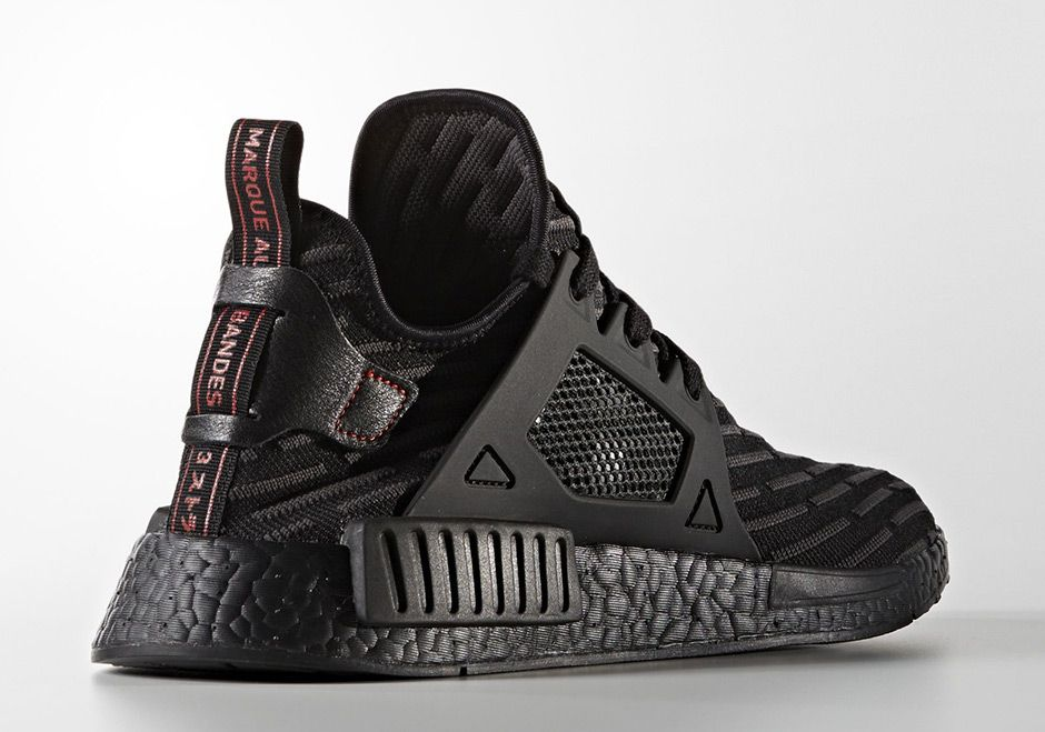 4cd538dc7eaa4 The adidas NMD XR1 Triple Black is headed to retailers featuring R2 Primeknit  patterns throughout for a unique look. Release coming March 2017