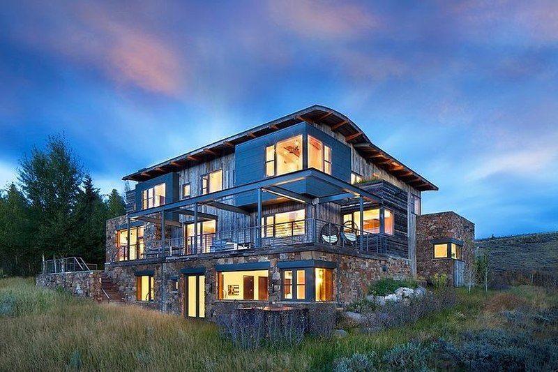 Splendide maison bois et pierre avec sa toiture cintrée aux Usa