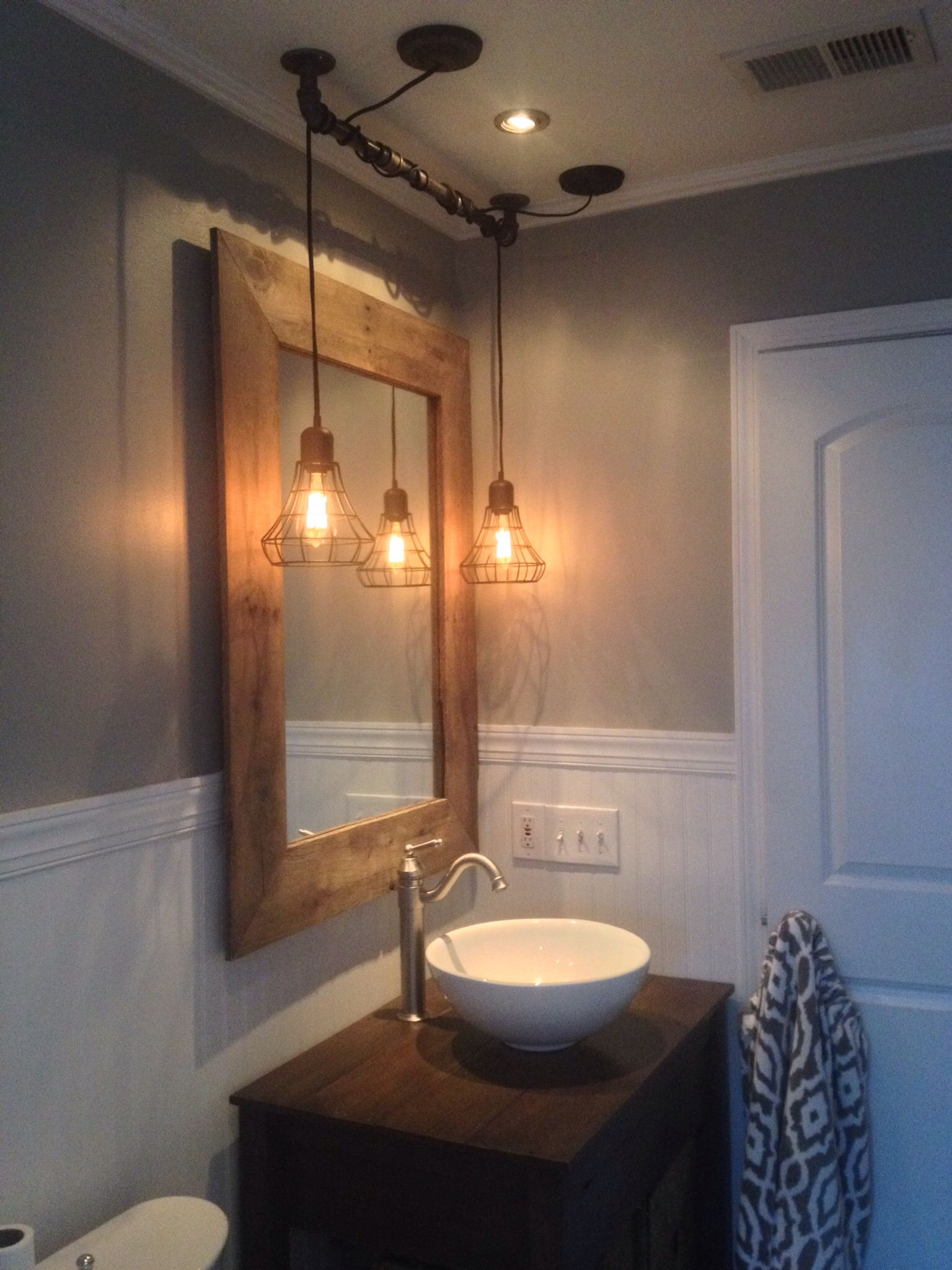 bathroom lighting pinterest vintage reclaimed wood mirror and vanity with industrial 10926