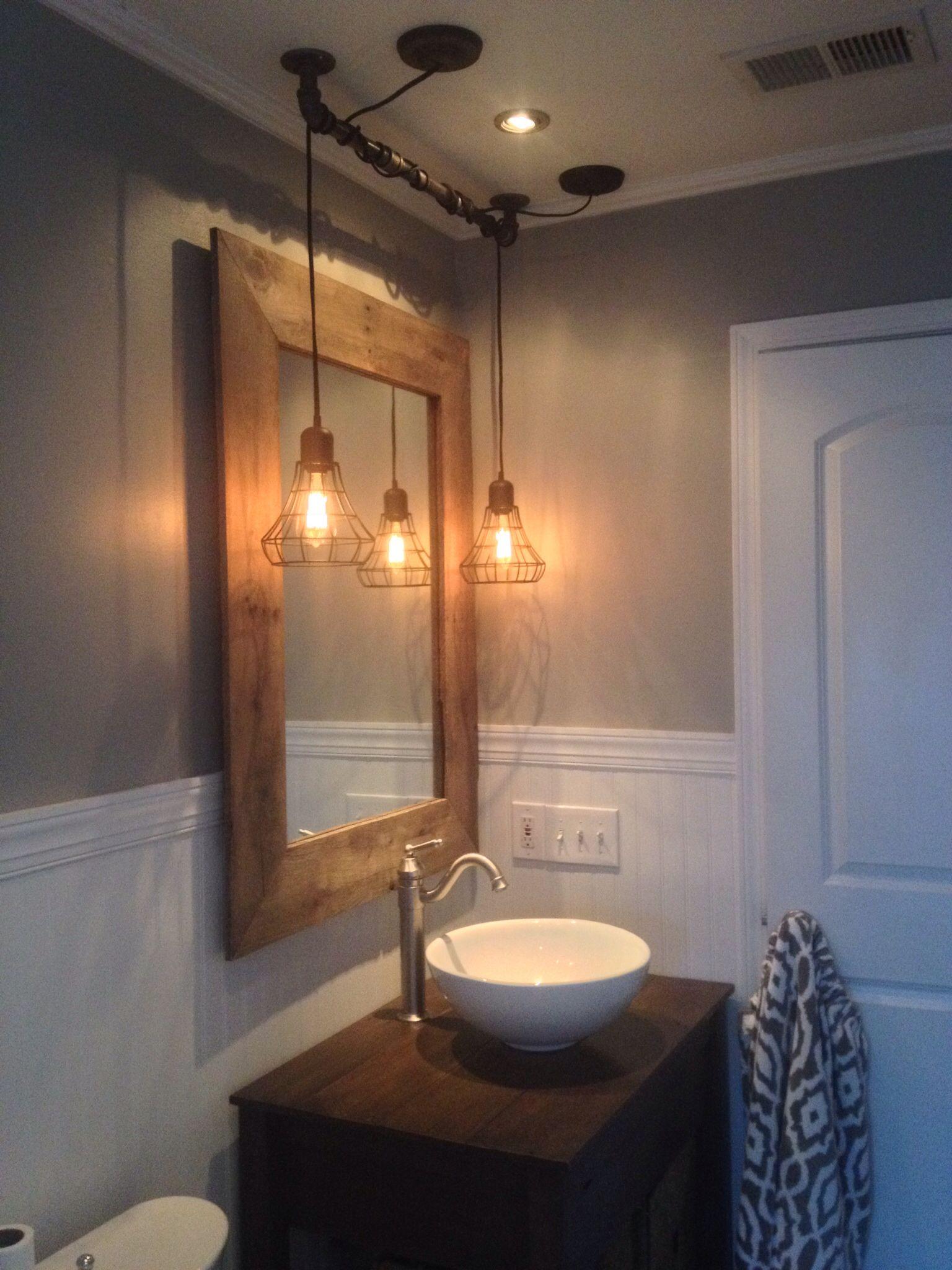 Bathroom Light Fixtures Atlanta Ga vintage reclaimed wood mirror and vanity with industrial lighting