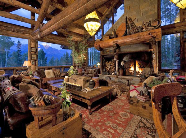 So many amazing details in this log home greatroom, from the massive fireplace with huge split log mantle, to the antique wood pot with vintage books....very cozy and rustic!