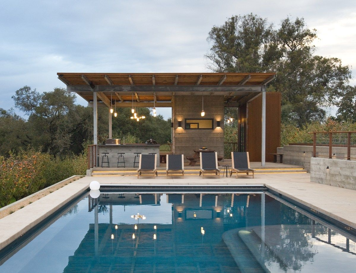 Modern Outdoor Kitchen Overlooking Swimming Pool With Apple Orchard Background Pool Gazebo Modern Outdoor Kitchen Outdoor Kitchen Modern outdoor pool areas
