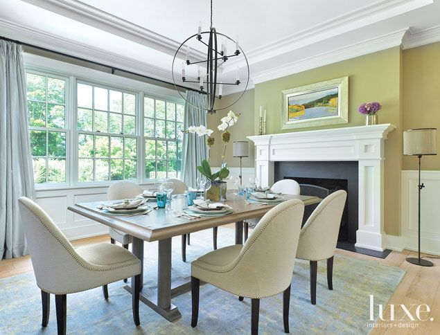 A Wolf Kahn landscape painting presides over a custom table . Beautiful! #diningroom #luxe #homes #decor