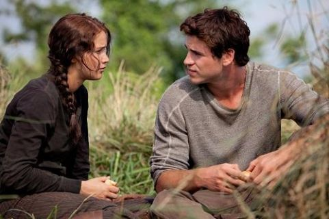 Jennifer Lawrence as Katniss Everdeen and Liam Hemsworth as Gale Hawthorne in 'The Hunger Games.'
