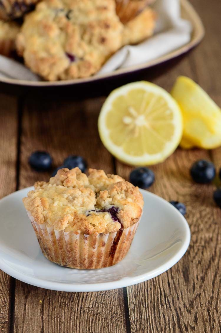Fabulous lemon blueberry muffins recipe — light, fluffy muffin with a hint of lemon and packed with blueberries. An all time favorite! | bakedbyanintrovert.com