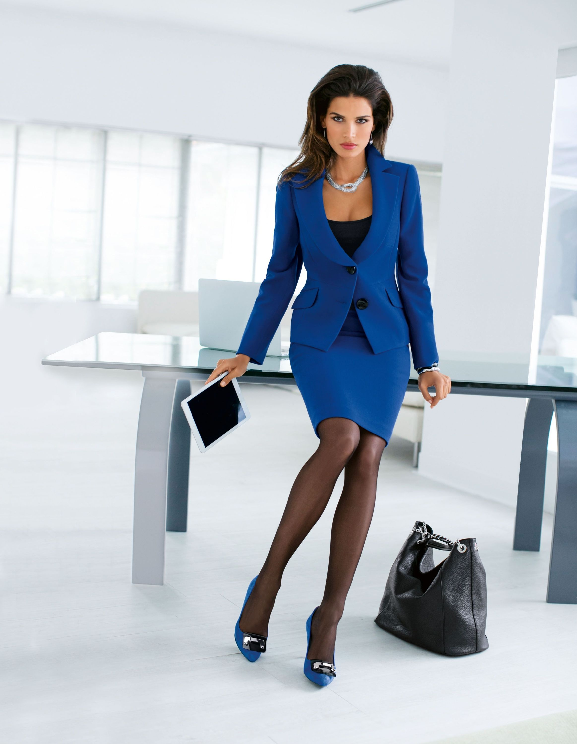 Colored suit to stand out. Nylons (not tights). Business ...
