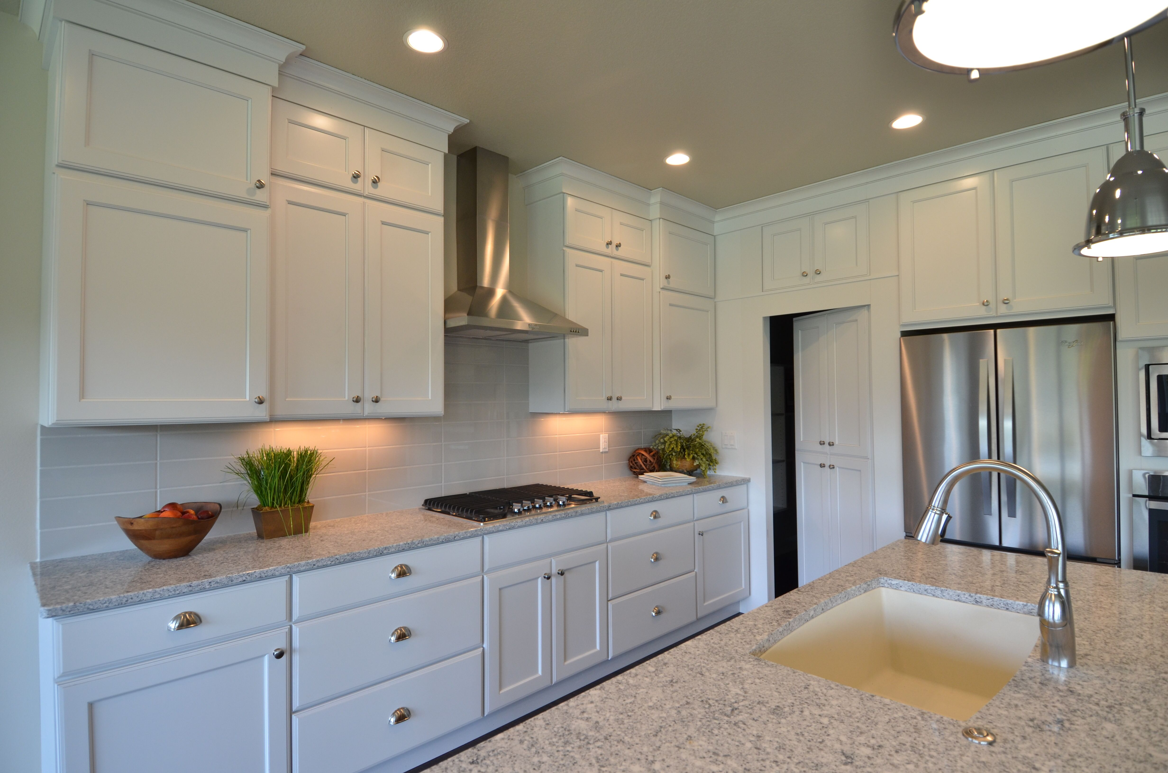 Add light to your home with white cabinets. The white ...