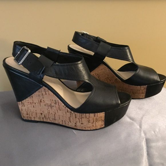 Franco Sarto Wedges Black leather with silver buckle, cork wedge.  Super cute and very easy to walk in.  Worn twice, in excellent condition. Franco Sarto Shoes Wedges