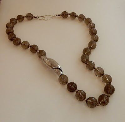 Hanna Peleg Jewelry: Synclastic spiral bead necklace