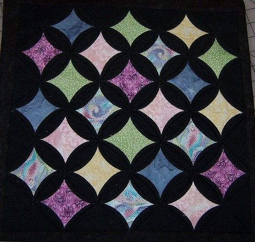 Love the black background! Cathedral Window Quilt Pattern by ... : cathedral window quilt instructions - Adamdwight.com