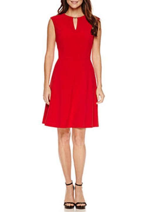 Red Flair: Your Valentine won't stop smiling after once they see you in this sleeveless fire-red dress with a keyhole neckline. Click through to see more dress style ideas for Valentine's Day.