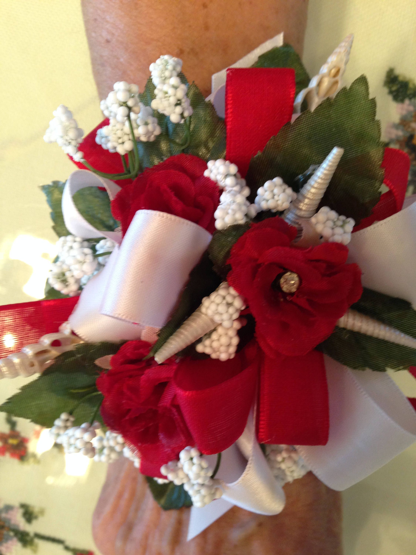 Beach wedding silk flower and shell wrist corsage with miniature beach wedding silk flower and shell wrist corsage with miniature red garden roses mightylinksfo